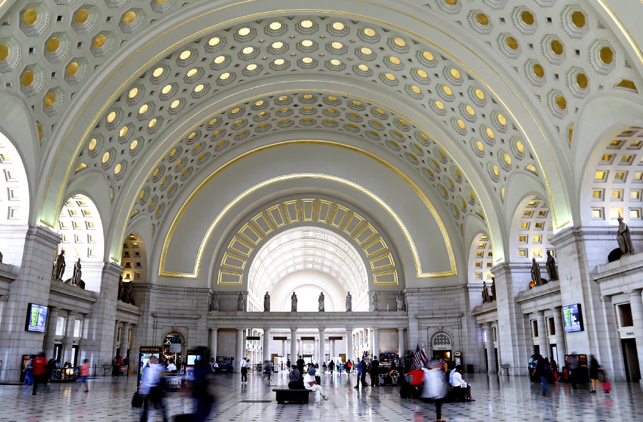 interior photo of Union Station in Washington, DC showing blurred motion of people walking
