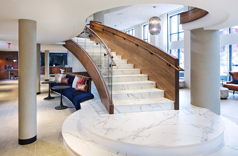 Staircase in the multi-story lobby at Union Place leading up to the second level and surrounded by seating areas