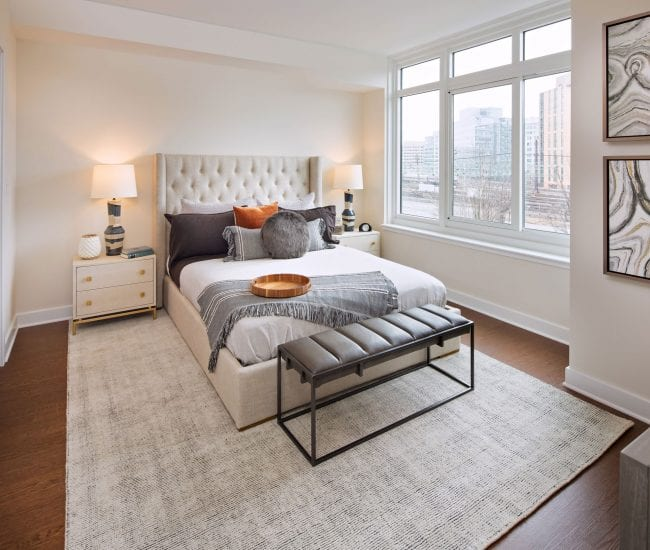 Bedroom at Union Place with wood-style flooring and large windows with a view of DC