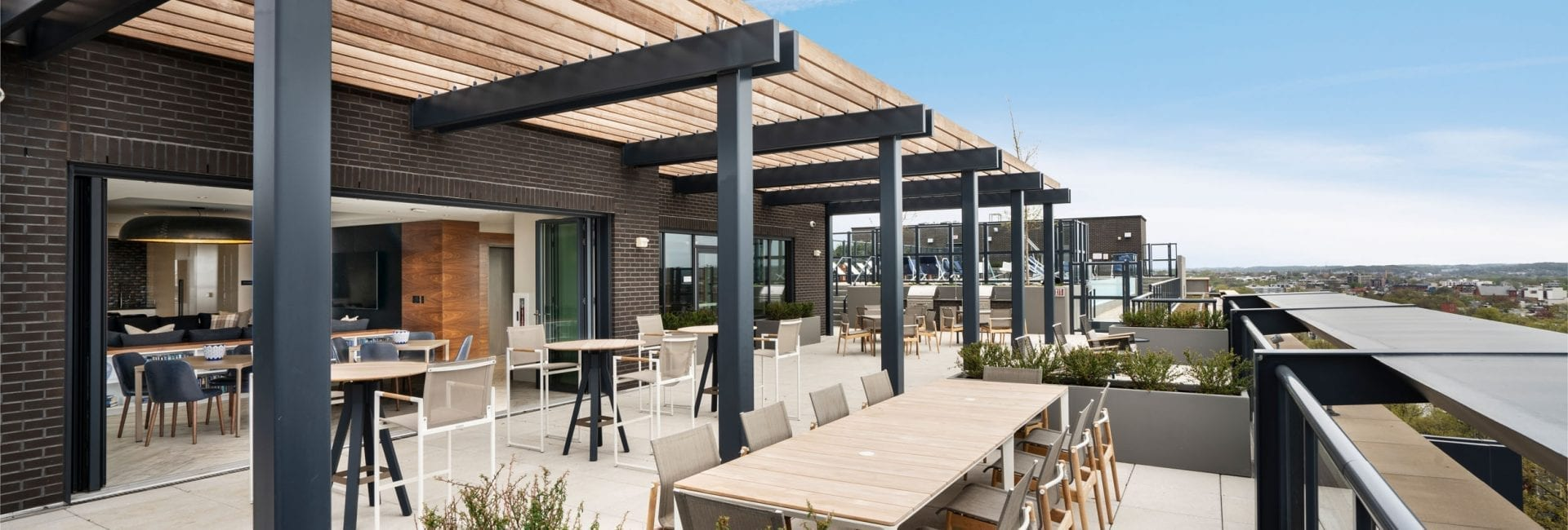 Rooftop at Union Place with seating areas, fire pits, and grilling stations