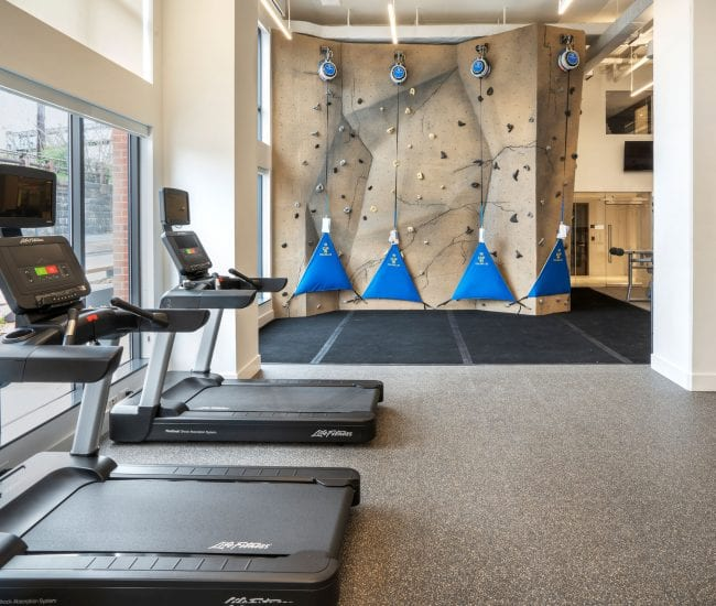 Union Place fitness center with rock climbing wall and treadmills