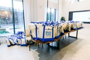 Blue and white tote bags with Union Place logo