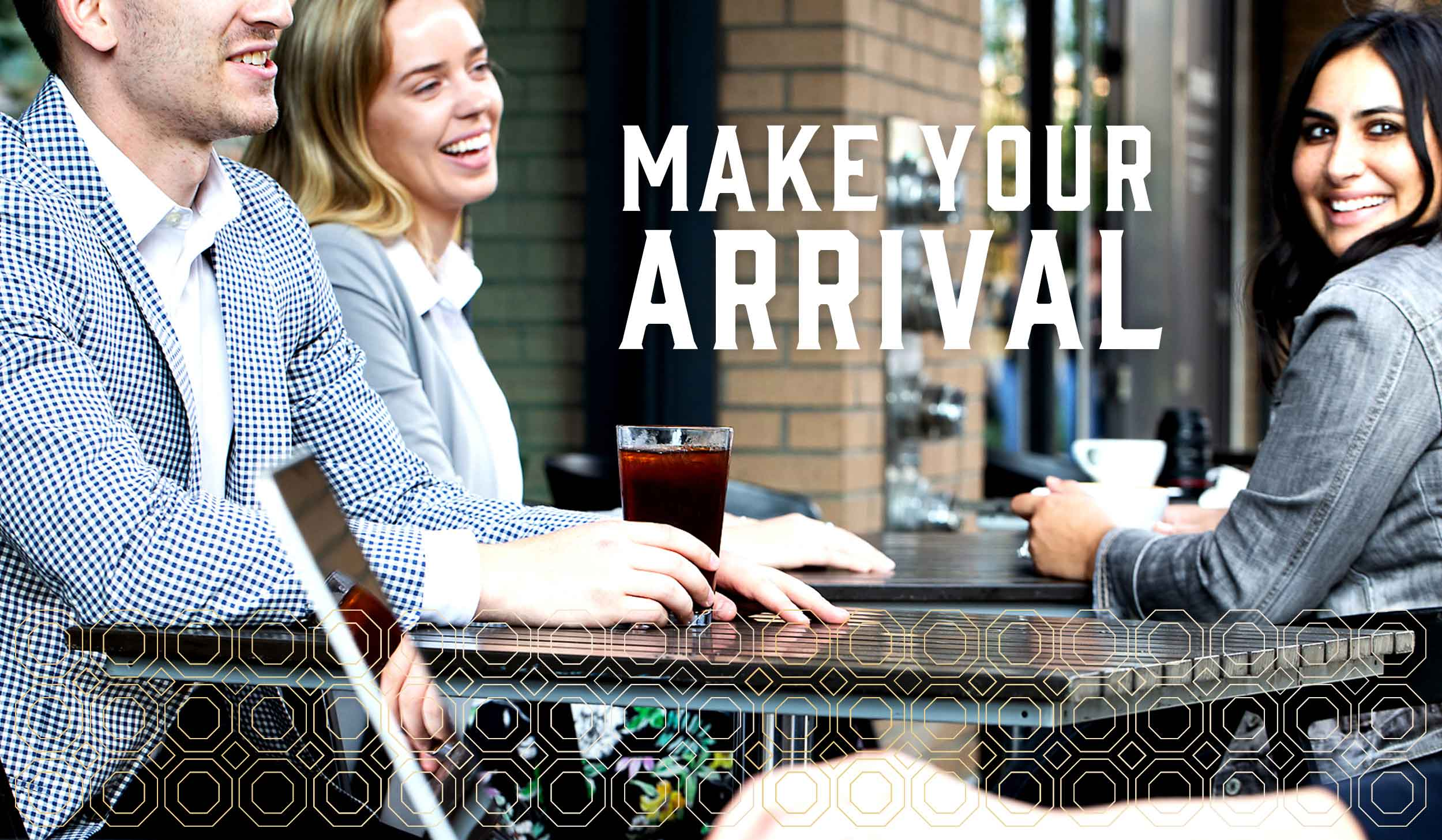 photo of two women and one man smiling at a street side cafe with Make Your Arrival text overlay